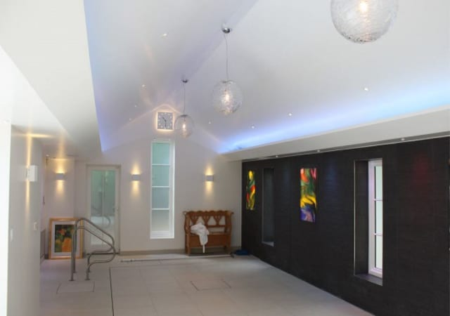 Residential extension showing raised floor of indoor swimming pool